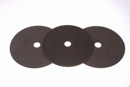 Abrasive cut-off wheel for ferrous metals or industrial steel on white background