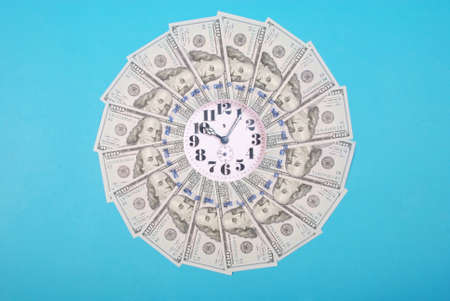 Concept of clock and dollar. Clock on mandala kaleidoscope from money. Abstract money background raster pattern repeat mandala circle. On blue background.
