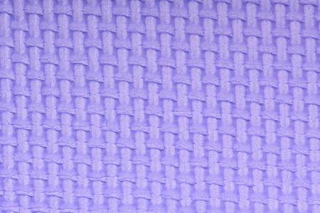 Texture of a polyethylene violet shine gym mat. Yoga mat texture. Violet polyethylene foam travel mat texture. High resolution photo.