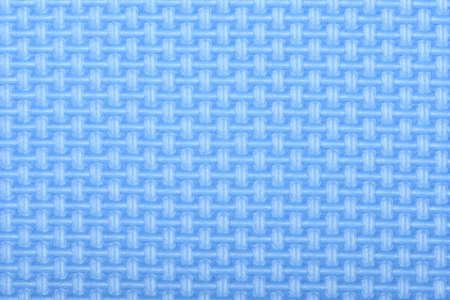 Texture of a polyethylene blue shine gym mat. Yoga mat texture. Blue polyethylene foam travel mat texture. High resolution photo.