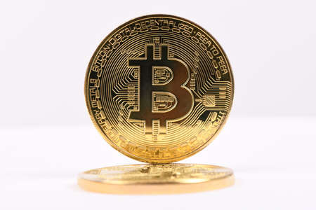 Golden bitcoin isolated on white background. Front and back sides are shown. High resolution photo. . Full depth of field.