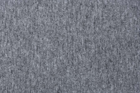 Grey jersey fabric texture background. High resolution photo. Full depth of field.