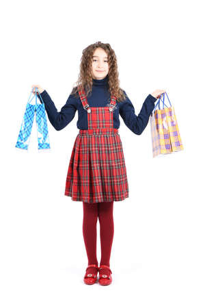Child with a packaging checkered texture isolated on white background. Girl likes shopping on sale season. Holiday present, shopping.