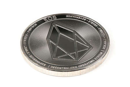 Back side of the crypto currency, silver EOS isolated on white background. High resolution photo. Full depth of field.