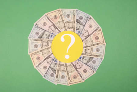 Question mark on mandala kaleidoscope from money. Abstract money background raster pattern repeat mandala circle.
