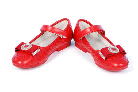 Chilren red shoes on white background. High resolution photo. Full depth of field.