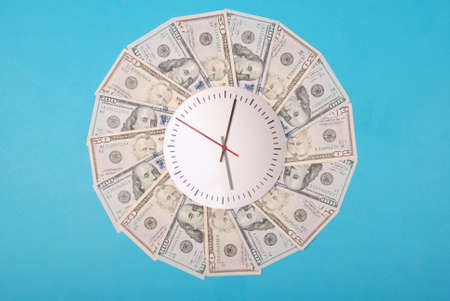 Concept of clock and dollar. Clock on kaleidoscope from money. Abstract money background raster pattern repeat circle. On blue background. High resolution photo.