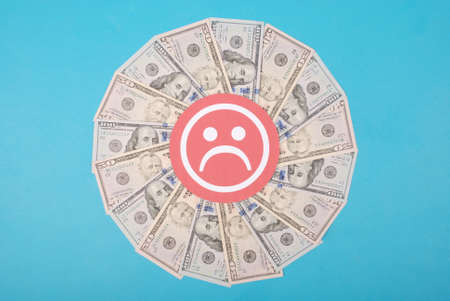 Sad smile faces on kaleidoscope from money. Abstract money background raster pattern repeat circle. On blue background. High resolution photo. Stockfoto