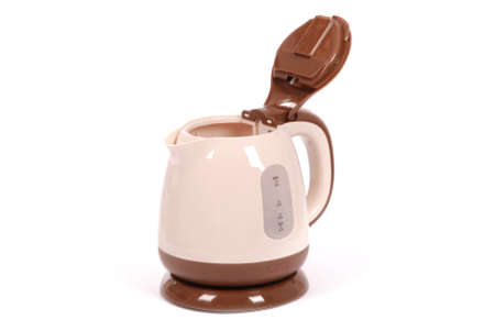 Electric kettle, isolated on white. Stylish modern beige and brown. High resolution photo. Full depth of field.