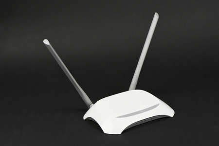 White WIFI router with two antennas isolated on black background, Clipping path inside. High resolution photo. Full depth of field. Фото со стока
