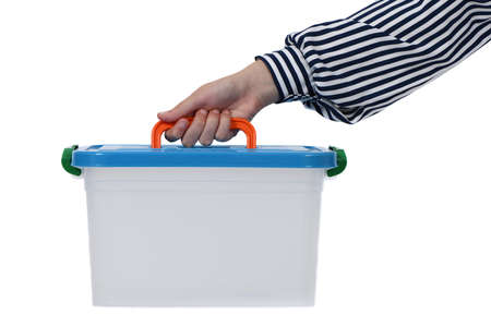 Child hand holding plastic container isolated on white background. High resolution photo. Full depth of field.