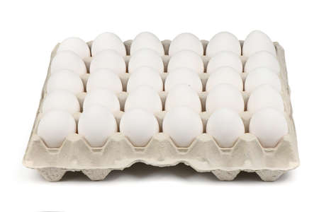 30 farm fresh white eggs in a tray isolated on white background. High resolution photo. Full depth of field.