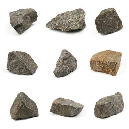 Neun Grungy Granitstein, Marmorfelsen isoliert auf weißem Hintergrund. Hochauflösendes Foto. Volle Schärfentiefe. Standard-Bild