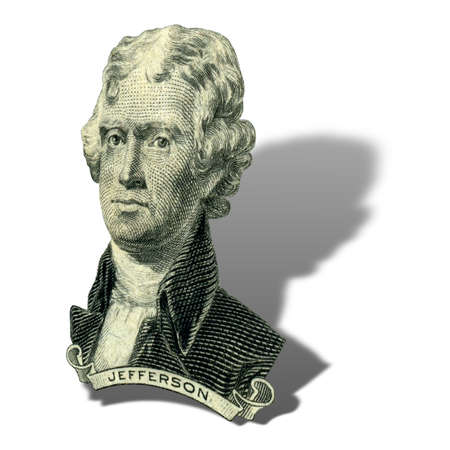 Portrait of former U.S. president Thomas Jefferson as he looks on two dollar bill obverse. Photo at an angle of 45 degrees, with a shadow.