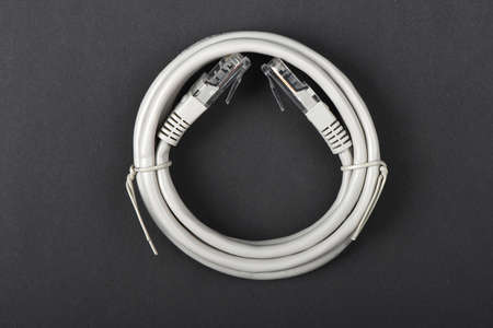 Network Cable CAT6 Flat 2m RJ45 Lan Internet isolated on black Background. High resolution photo. Full depth of field.