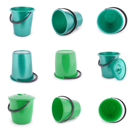 Nine green plastic bucket isolated on a white