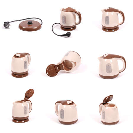 Nine electric kettle, isolated on white. Stylish modern beige and brown.
