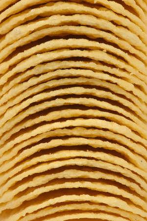 Background of tasty crispy potato chips. High resolution photo. Full depth of field. Reklamní fotografie