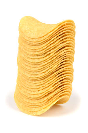 Tasty crispy potato chips stacked isolated on white background. High resolution photo. Full depth of field.