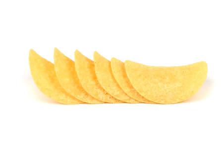 Tasty crispy potato chips isolated on white background. High resolution photo. Full depth of field.