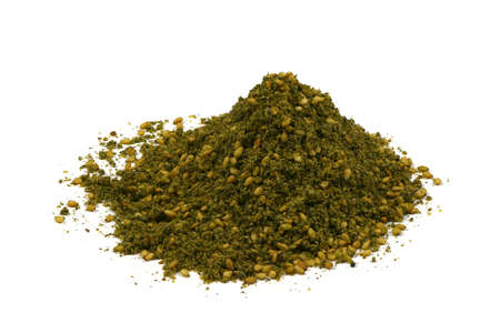 Za'atar (zatar), blend of herbs, sesame seeds and salt in pile on white background. High resolution photo. Full depth of field.