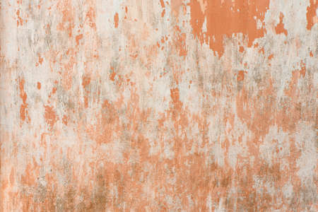 Old antiquity street wall with dust and scratched grunge textures with paint stains, cracks, streaked on gray-orange stucco wall background. High resolution photo. Full depth of field (DOF).