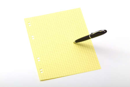 denunciation: The photo of a dark ball pen which itself writes on a color squared paper