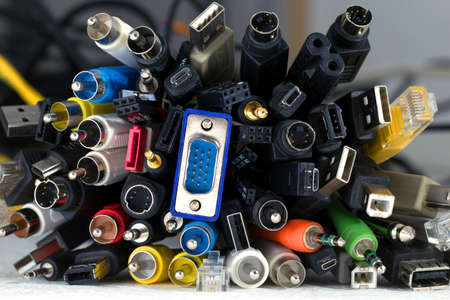connective: Bunch of great number of different colored cables with various connectors for various devices