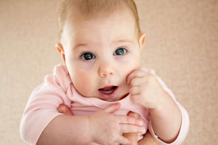 Close-up portrait of breastfed child with emotions and gaze Stock Photo