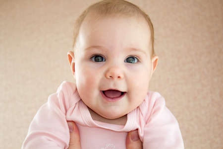 cordiality: Close-up portrait of breastfed child with emotions and gaze Stock Photo