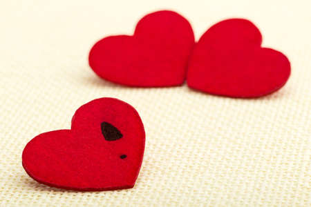 lonely heart: Lonely heart with a female track in front of two other hearts