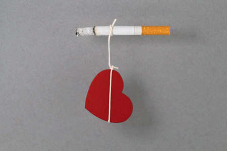 dependent: Heart as symbol of life is connected with cigarette and it is dependent on cigarette