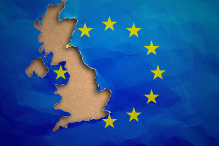Piece in form of UK borders torn out from the flag of the European Union. United Kingdom withdrawal from the European Union. Brexit concept Stock Photo