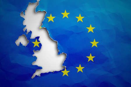disconnecting: Piece in form of UK borders torn out from the flag of the European Union. United Kingdom withdrawal from the European Union. Brexit concept Stock Photo
