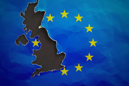 disintegration: Piece in form of UK borders torn out from the flag of the European Union. United Kingdom withdrawal from the European Union. Brexit concept Stock Photo