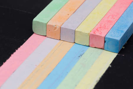 trustworthiness: Colored chalks paint stripes of other colors. Concept of universal skills and interchangeability in team Stock Photo