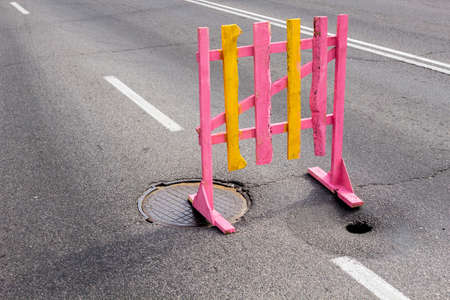 pits: Bright temporary wooden barrier pits on road Stock Photo