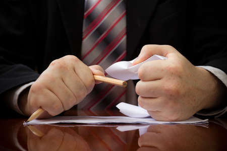 Businessman Has Received And Read Unpleasant Business Correspondence, He Was Angry And Crumpled It Up And Broke Pencil. Concept Of Trouble And Failure In Business. Close-Up Stock Photo