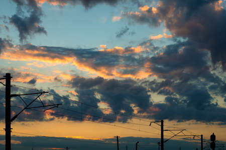gloaming: Power poles at background of sky landscape at sunset