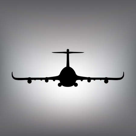 The black silhouette of an airplane. Plane in the air. Front view.