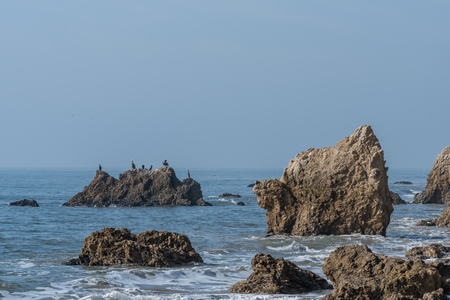 Winged lion shaped natural rock formation at the El Matador State Beach in Malibu, California Stock Photo