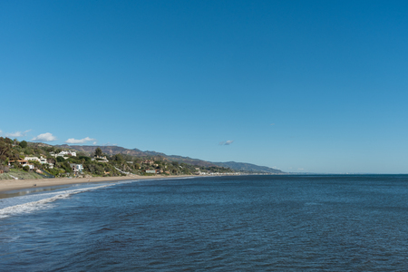 Panoramic view of Malibu coastline taken from a pier in Paradise Cove, Malibu, California, on a very clear winter day Stock Photo