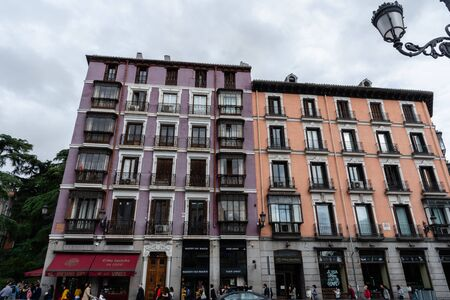 Madrid, Spain - Scenic Madrid street vista with beautiful colorful buildings across the street from the Royal Palace