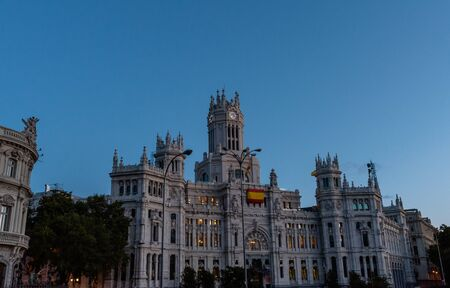 Scenic Madrid street vista at dusk, Communications Palace