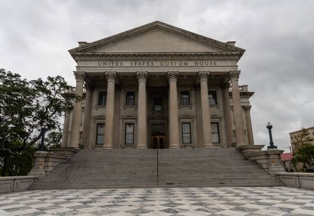 Facade of the United States Custom House building in Charleston, South Carolina, on a rainy day