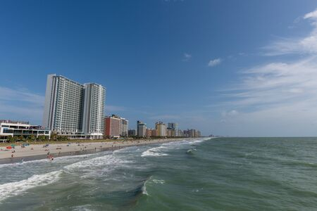 Beautiful panoramic Myrtle Beach vista on a gorgeous sunny day, lots of people on the beach