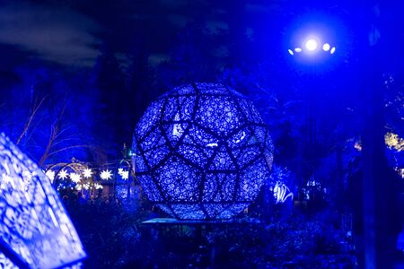 Enchanted forest of light - brightly illuminated intricate metal structure