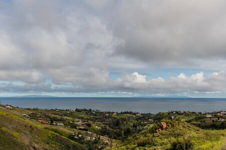 Scenic Malibu vista after a rainstorm, Southern California, with clear view of the Santa Monica Bay and Palos Verdes in the background