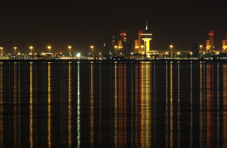 Power plants of Bahrain with beautiful reflection on sea at night