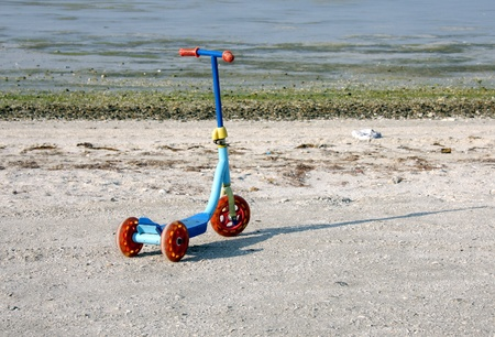 A beautiful sliding tricycle on a sea beach